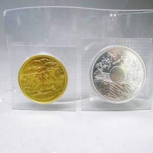 天皇陛下御在位六十年 拾万円 金貨 壱万円硬貨 2枚